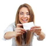 Woman smiling holding the card Royalty Free Stock Images
