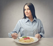 Woman with plate of pasta Royalty Free Stock Photos