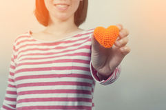 Woman Smiling and Holding heart shaped, Valentines day Concept. Royalty Free Stock Image