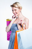 Woman smiling and holding paper bags Royalty Free Stock Images