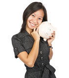 Woman smiling holding a piggy bank Stock Photo