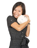 Woman smiling holding a piggy bank Stock Images