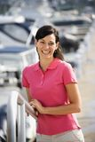 Woman smiling and holding railing. Royalty Free Stock Photo