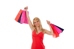 Woman smiling holding shopping bags royalty free stock photos