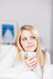 Woman Smiling While Holding Tee Cup Royalty Free Stock Image