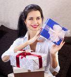 Woman smiling and holds blue gift box Royalty Free Stock Images