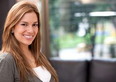 Woman smiling at home Stock Image
