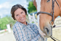 Woman smiling with horse Stock Photography