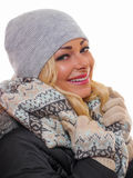 Woman smiling. Image of a attractive woman dressed for winter smiling royalty free stock photo