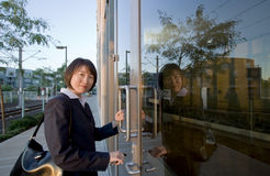 Woman Smiling In Front Of Doors - Horizontal Royalty Free Stock Image