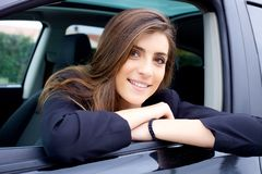 Woman smiling inside car looking happy closeup stock photo
