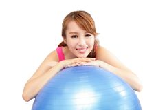 Woman smiling leaning on pilates ball Stock Photos