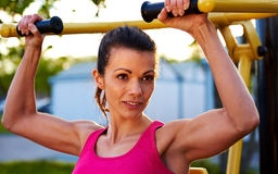 Woman smiling while lifting weights Royalty Free Stock Images