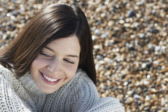 Woman Smiling While Looking Away At Beach Royalty Free Stock Images