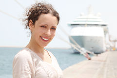 Woman smiling and looking at camera, big cruise Stock Photography