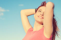 Woman smiling looking up to blue sky celebrating enjoying freedom. Closeup portrait woman smiling looking up to blue sky celebrating enjoying freedom. Positive Stock Image