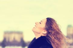 Woman smiling looking up to blue sky taking deep breath stock images