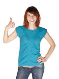 Woman smiling and making thumbs up gesture Stock Images
