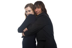 Woman and smiling man in black jacket holding her. Woman and smiling men in black jacket holding her. Isolated photo with white background Royalty Free Stock Photo