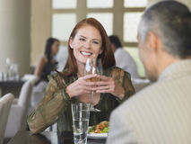 Woman Smiling At Man Over Meal In Restaurant Royalty Free Stock Image