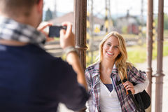 Woman smiling man taking her picture vacation Stock Photos