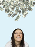 Woman smiling at money rain Royalty Free Stock Photo