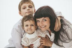 Woman smiling mother that kissing kids Stock Image