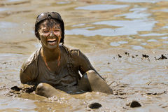 Woman smiling in the mud. BOISE, IDAHO/USA - AUGUST 11:Unidentified woman stuck in the pit sitting on her bum at the The Dirty Dash in Boise, Idaho on August 11 Stock Photo
