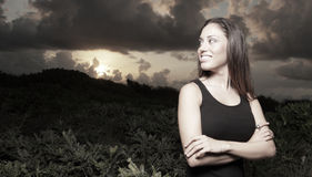 Woman smiling in a nature setting Stock Images