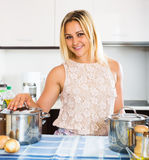 Woman smiling at new kitchen Stock Photo