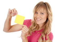 Woman smiling with note Royalty Free Stock Image