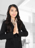 Woman smiling at the office. Young businesswoman smiling at the office Royalty Free Stock Images