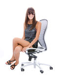 Woman smiling on office chair. Close up of fashionable woman sit on office chair smiling, isolated on white background Stock Image