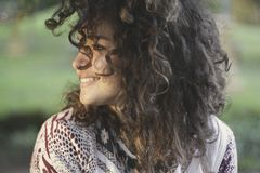 Woman smiling in outdoor portrait Stock Image