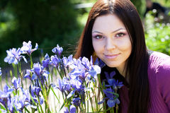 Woman smiling outdoors with some flowers Stock Image