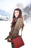 Woman smiling outside in winter time. Beautiful young woman smiling outside in winter time Royalty Free Stock Images