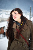 Woman smiling outside in winter time. Beautiful young woman smiling outside in winter time Royalty Free Stock Photos