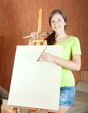 Woman smiling while painting a picture Stock Photos