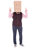 Woman in smiling paper bag on head Stock Images
