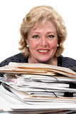Woman smiling with paperwork Stock Image