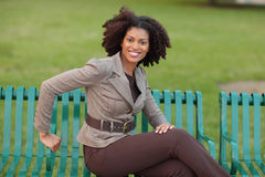 Woman smiling in the park Stock Photos