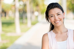 Woman smiling at the park Royalty Free Stock Photography