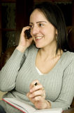 Woman smiling on phone Stock Images