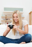Woman smiling at a photo on her camera Royalty Free Stock Image