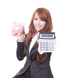 Woman smiling with piggy bank and calculator Stock Images