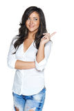 Woman smiling pointing up showing copy space Royalty Free Stock Photos