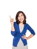 Woman smiling pointing up showing copy space. Royalty Free Stock Photography