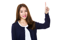 Woman smiling pointing up showing copy space Stock Photography