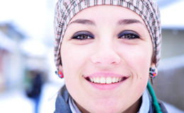 Woman smiling portrait. Clouse-up portrait of a smiling girl in winter set-up Royalty Free Stock Image