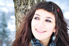 Woman smiling portrait. Close-up portrait of a beautiful young woman smiling outside in winter time Royalty Free Stock Images